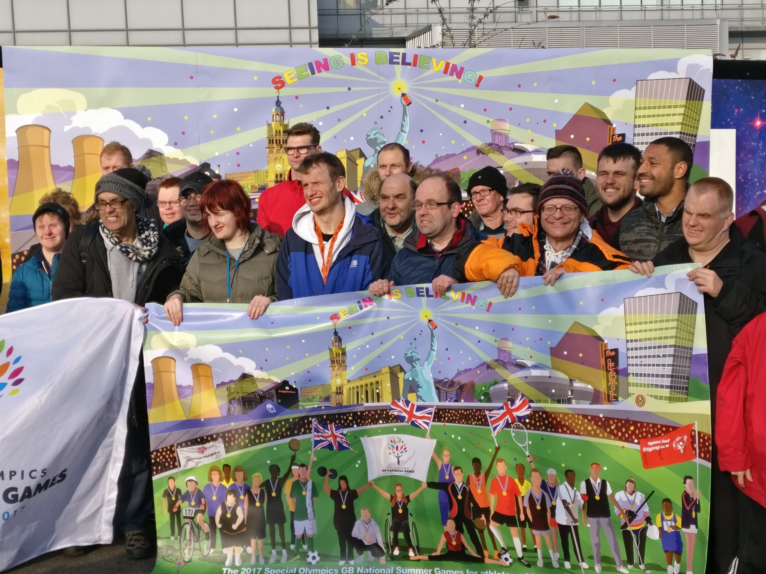 Artists and athletes involved in the creation of the Special Olympics mural