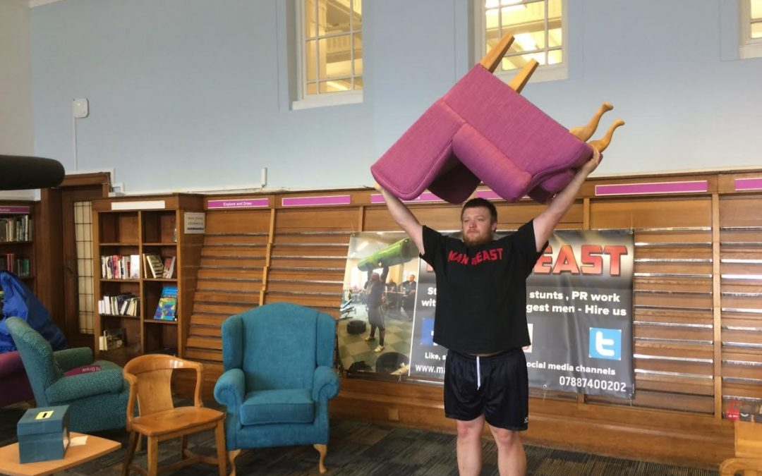 England's Strongest Man helps move furniture into new reading room at Sheffield Central Library
