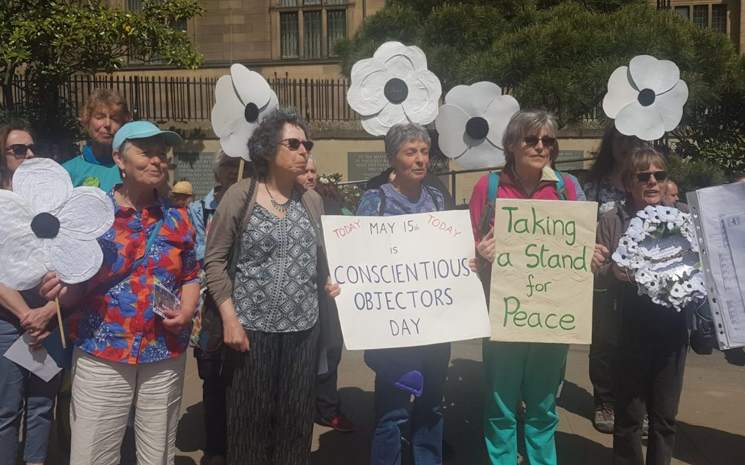 Activists march in International Conscientious Objectors Day